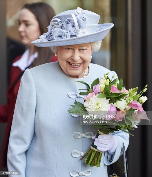 Britain's Queen Elizabeth II leaves the Royal Albert Hall in central London on June 4 after attending the Centenary annual Meeting of the National...