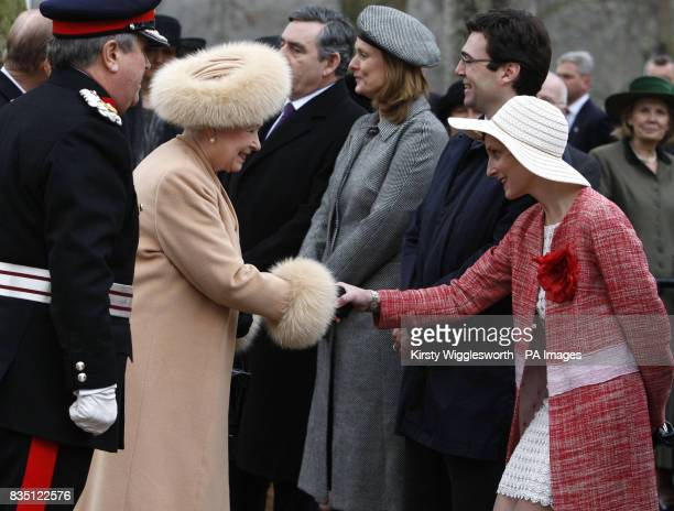 Britain's Queen Elizabeth II left shakes hands with MarieFrance van Heel wife of Britain's Minister of Culture Media and Sport Andy Burnham during...
