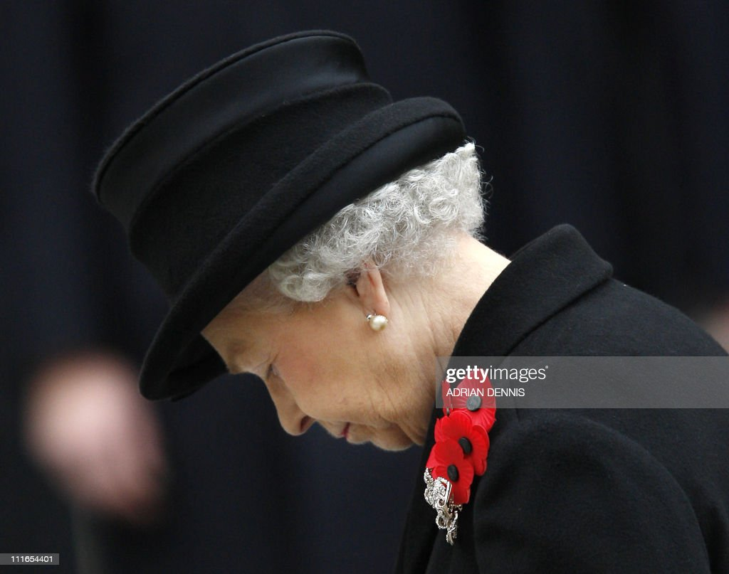 Britain's Queen Elizabeth II listens to a prayer during the Remembrance Sunday service at The Cenotaph in Whitehall, London, on November 9, 2008. Members of the Royal Family join former and current members of the services to remember the dead of the UK and Commonwealth on the Sunday before Armistice Day. AFP PHOTO / Adrian Dennis