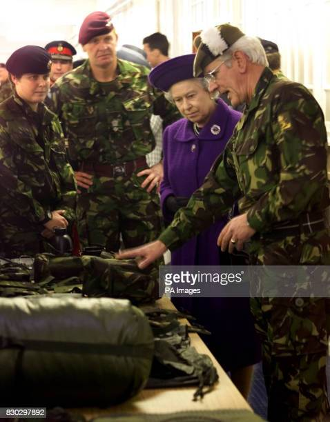 Britain's Queen Elizabeth II looks at some of the equipment issued to reservists prior to operational deployment in the Quartermaster's Store at...
