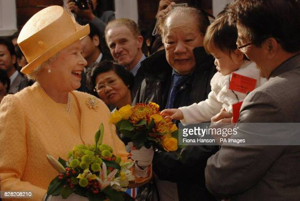 Britain's Queen Elizabeth II meets 16monthold Ong Wai Jun at the official opening of the Camden Chinses Community Centre London Thursday November 3...