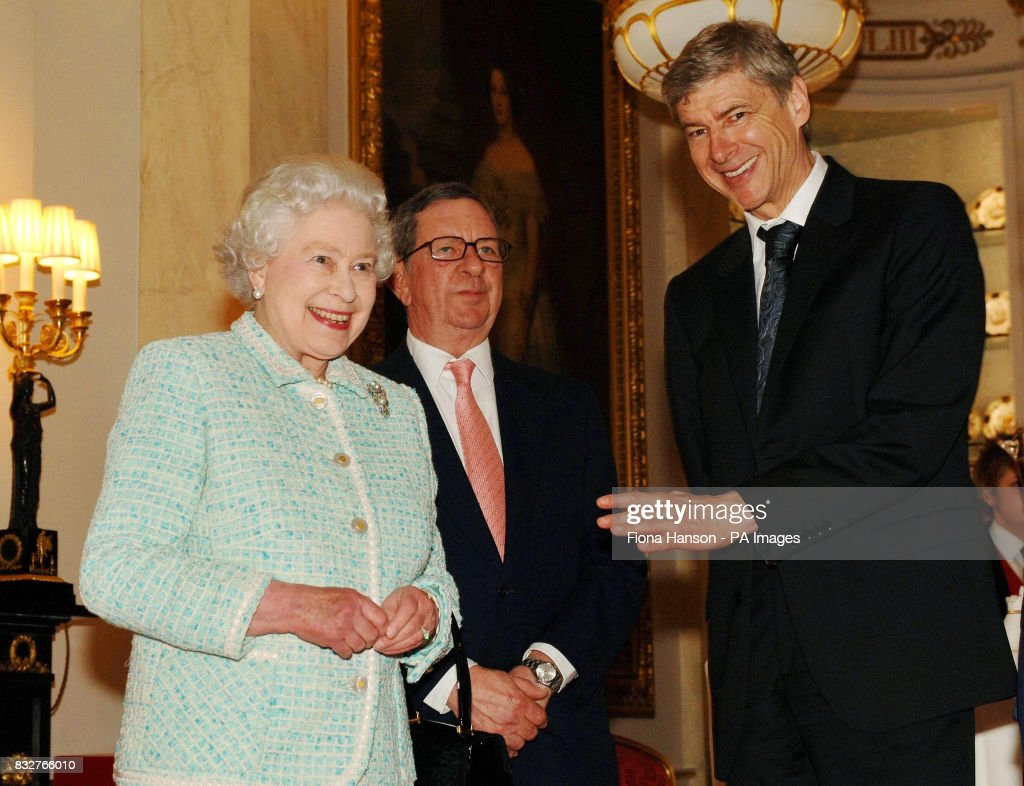 Britain's Queen Elizabeth II meets Arsenal chairman Peter Hill-Wood and manager Arsene Wenger (right) at Buckingham Palace.