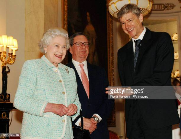 Britain's Queen Elizabeth II meets Arsenal chairman Peter HillWood and manager Arsene Wenger at Buckingham Palace