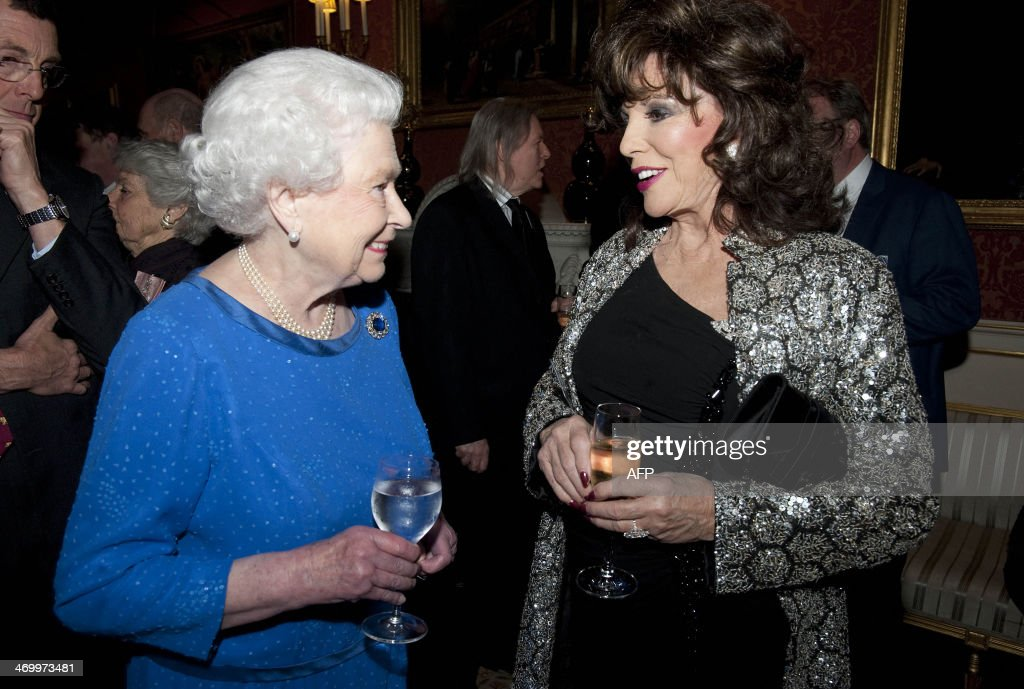 Britain's Queen Elizabeth II (L) meets British actress Joan Collins during a Reception for the Dramatic Arts, at Buckingham Palace in London, on February 17, 2014.