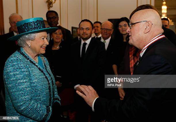 Britain's Queen Elizabeth II meets Canadian artist Charles Pachter from Pachter Hall and Moose Factory in Toronto during a visit to officially reopen...