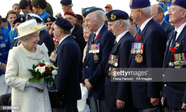 Britain's Queen Elizabeth II meets Canadian war veterans during a ceremony at the Vimy memorial near Lille in northern France