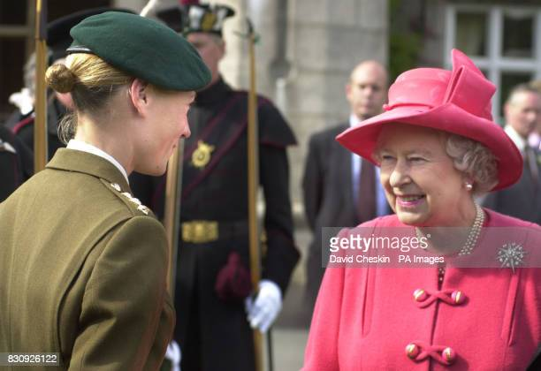 Britain's Queen Elizabeth II meets Capt Philippa Tattersall the first woman Army Commando on the lawn of Balmoral castle Scotland * The Queen watched...