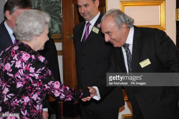 Britain's Queen Elizabeth II meets entrepreneur Sir Philip Green at St James's Palace in London during reception for business leaders celebrating the...