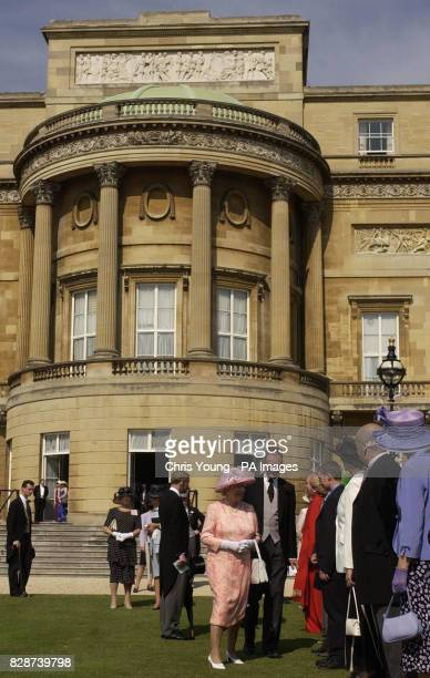 Britain's Queen Elizabeth II meets guests during a Garden Party in the gardens of Buckingham Palace her official London residence * The Queen should...