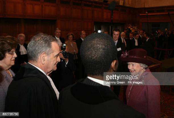 Britain's Queen Elizabeth II meets judges from the International Court of Justice as she visits the ICJ in The Hague in the Netherlands PRESS...