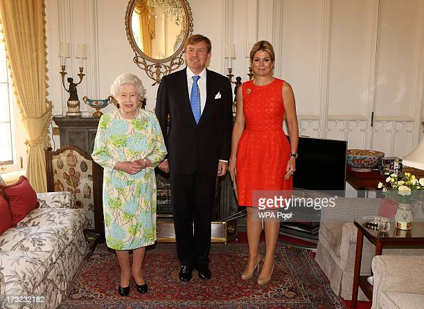 Britain's Queen Elizabeth II meets King WillemAlexander and his wife Queen Maxima of the Netherlands at Windsor Castle on July 10 2013 in Windsor...