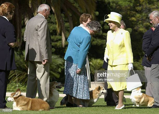 Britains Queen Elizabeth II meets members of the Adelaide Hills Kennel Club and their Corgis in the gardens of the Government House February 28 2002...