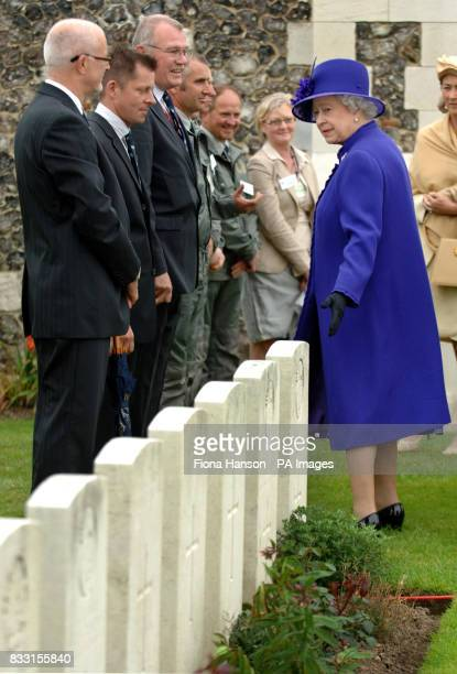 Britain's Queen Elizabeth II meets members of the Commonwealth War Graves Commission during a visi to the Tyne Cot War Cemetery Passchendaele for WWI...