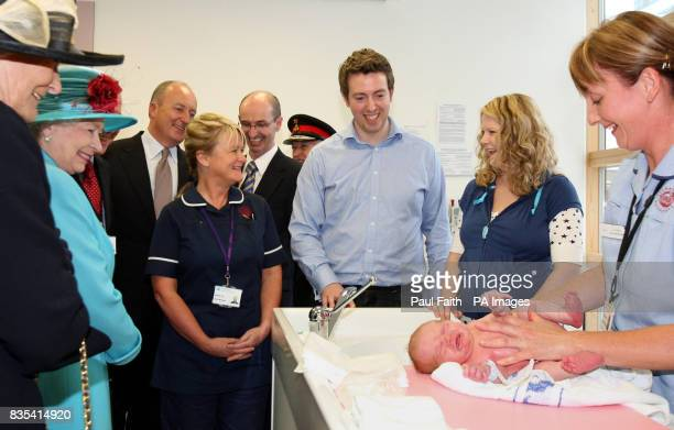 Britain's Queen Elizabeth II meets parents David and Davina Roche with newborn son James William Roche at Altnagelvin Hospital at the start of...