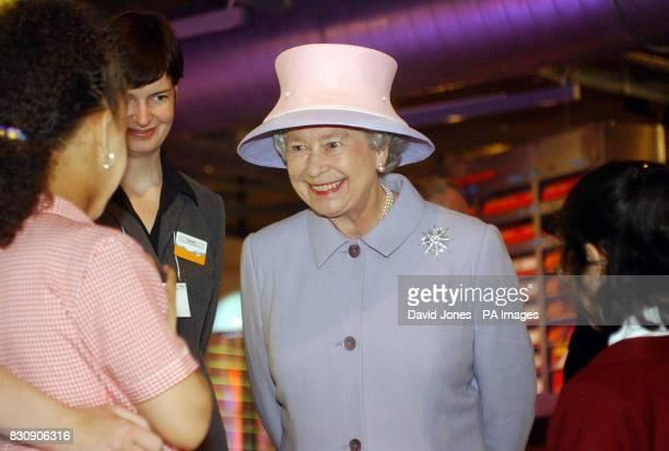 Britain's Queen Elizabeth II meets pupils from Preistley Smith Primary school Erdington during a visit to Think Tank Birmingham's new museum of...