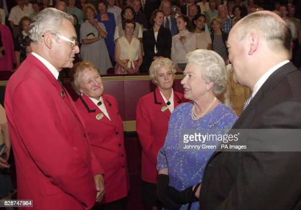 Britain's Queen Elizabeth II meets Royal Albert Hall steward John Miller from Cheltenham and fellow stewards Peggy Duffin from Bromley in Kent and...