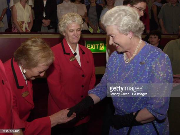 Britain's Queen Elizabeth II meets Royal Albert Hall steward Peggy Duffin from Bromley in Kent during the interval of this year's 17th BBC Prom held...