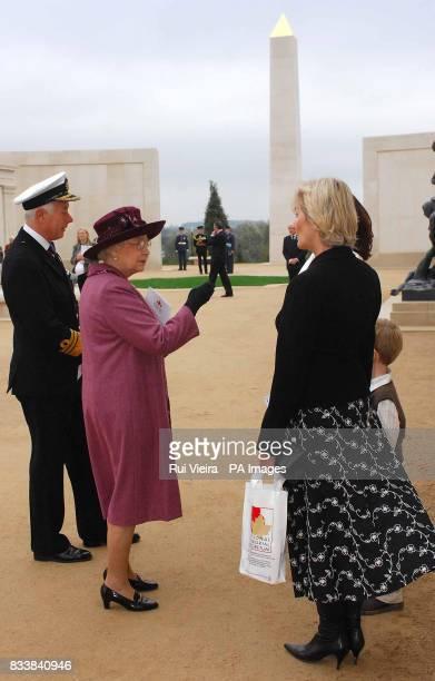 Britain's Queen Elizabeth II meets Sally EytonJones whose husband John Eyton Jones never returned after Sea Harrier mission in the Falklands after...
