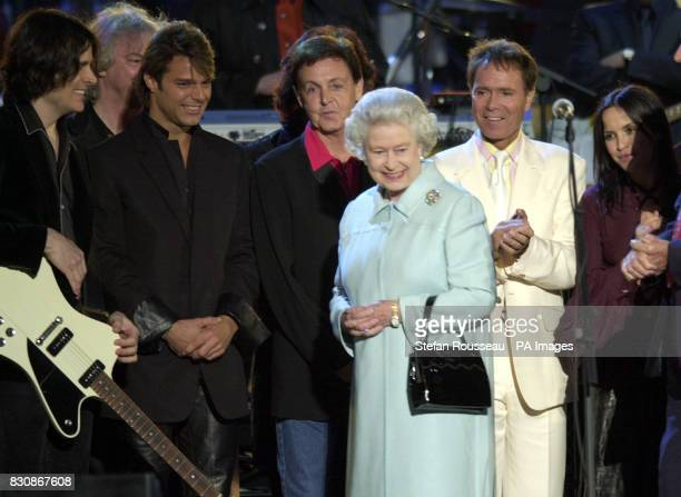 Britain's Queen Elizabeth II meets Sir Paul McCartney Sir Cliff Richard and other peeformers on stage in the gardens of Buckingham Palace after the...