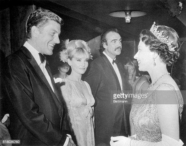 Britain's Queen Elizabeth II meets some of the current 'royalty' of the movies in London Exchanging greetings with the Queen are Dick Van Dyke Diane...