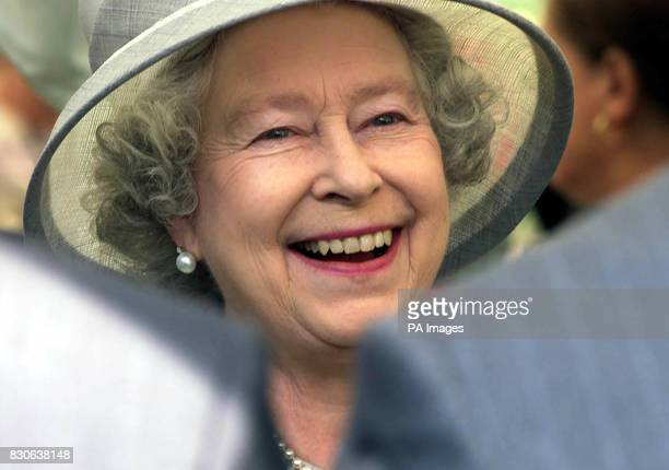 Britain's Queen Elizabeth II meets the public before visiting the Sunbury Millennium Embroidery in the walled garden Sunbury on Thames Middlesex *The...