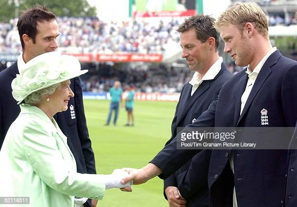 Britain's Queen Elizabeth II Meets With England's Andrew Flintoff As Marcus Trescothick And Michael Vaughan Look On During The First Day Of The...