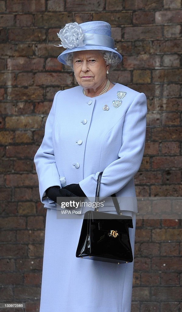 Britain's Queen <a gi-track='captionPersonalityLinkClicked' href=/galleries/search?phrase=Elizabeth+II&family=editorial&specificpeople=67226 ng-click='$event.stopPropagation()'>Elizabeth II</a> observes a ceremony during a visit to the Admiralty Board and Admiralty House on 23 November, 2011 in London, England. The Duke of Edinburgh was inaugurated as Lord High Admiral as well as formally receiving the Letters Patent, followed by a lunch given by the First Sea Lord at Admiralty House.