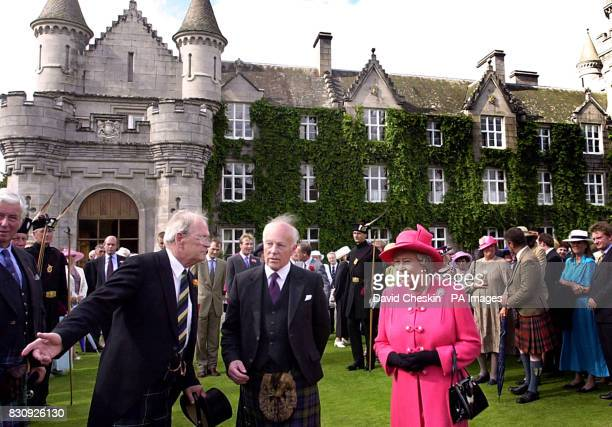 Britain's Queen Elizabeth II on the lawn of Balmoral castle Scotland The Queen watched the Highland Band of the Scottish Division Beating a Retreat...