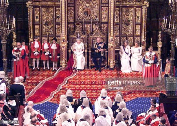 Britain's Queen Elizabeth II on the throne beside her husband Prince Philip waits for the start of the State Opening of Parliament 17 November 1999...