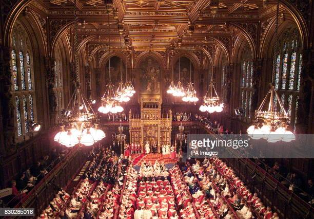 Britain's Queen Elizabeth II on the throne beside her husband The Duke of Edinburgh during the State Opening of Parliament in the House of Lords *...