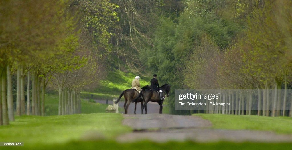 Britains Queen Elizabeth II Out Riding With A Groom In Windsor Home Park On Her 75th