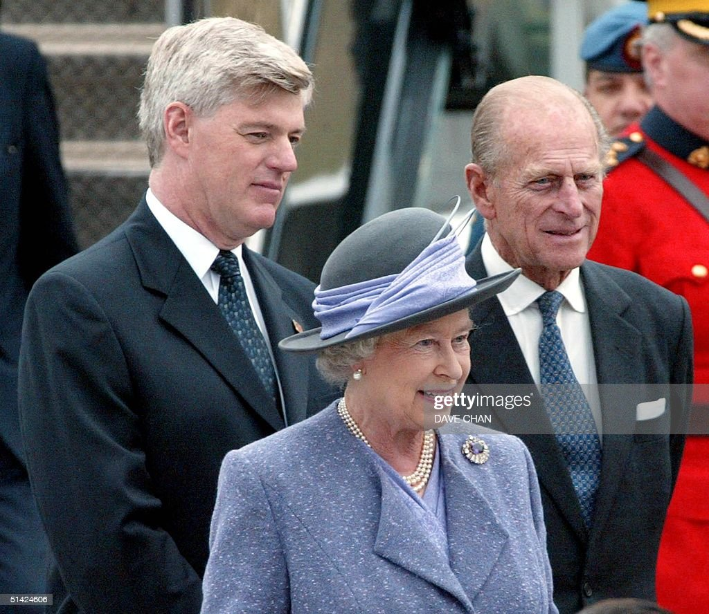 Britain's Queen Elizabeth II Prince Philip and Canadian Deputy Prime Minister John Manley watch 12 October 2002 during the arrival ceremony in Ottawa...