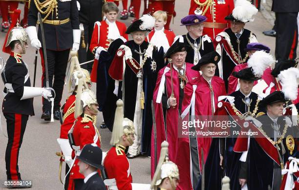 Britain's Queen Elizabeth II processes to attend the Order of the Garter Service in Windsor The Order of the Garter established by Edward III in 1348...