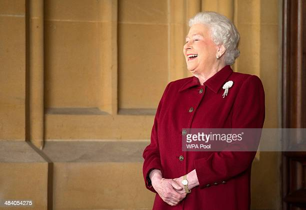 Britain's Queen Elizabeth II reacts as she bids farewell to Irish President Michael D Higgins and his wife Sabina at the end of their official visit...