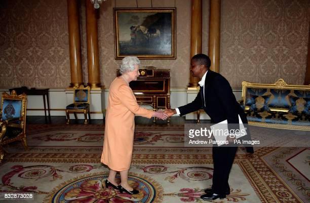 Britain's Queen Elizabeth II receives his his Excellency the Ambassador of Cote d'Ivoire Mr Djessan Philippe DjangoneBi