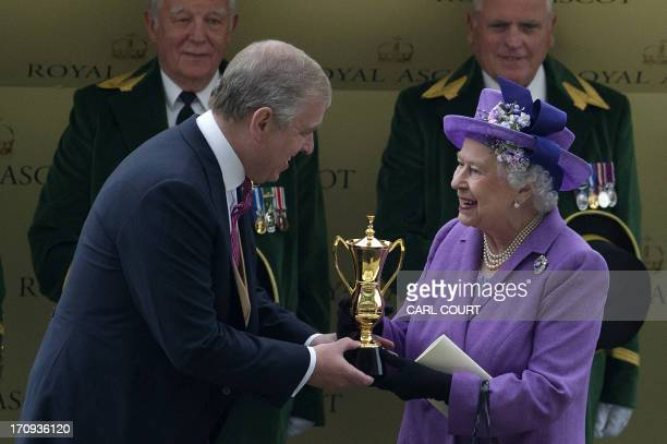 Britain's Queen Elizabeth II receives the Gold Cup trophy from Britain's Prince Andrew the Duke of York after her horse Estimate wins the Gold Cup on...