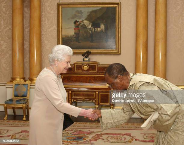 Britain's Queen Elizabeth II receives the High Commissioner for Sierra Leone Edward Turay at Buckingham Palace London