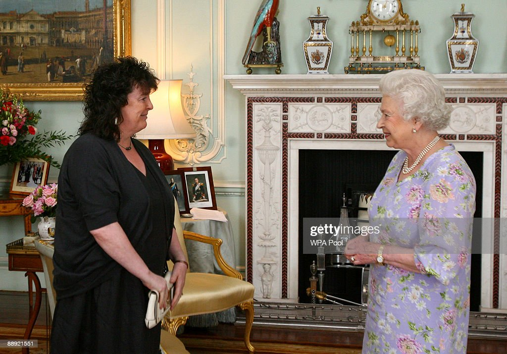 Britain's Queen <a gi-track='captionPersonalityLinkClicked' href=/galleries/search?phrase=Elizabeth+II&family=editorial&specificpeople=67226 ng-click='$event.stopPropagation()'>Elizabeth II</a> receives the incoming Poet Laureate, Professor Carol Ann Duffy, inside Buckingham Palace in on July 9, 2009 in London, United Kingdom. Professor Duffy, born in Glasgow but who now in Manchester, has won numerous awards for her collections of poetry including the Somerset Maugham Award for 'Selling Manhattan' (1987), the Whitbread Poetry Prize and Forward Poetry Prize for 'Mean Time' (1993) and the 2005 T.S. Eliot Prize for 'Rapture'.