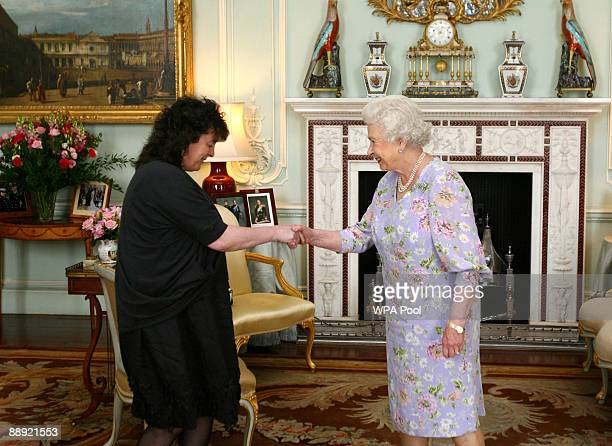 Britain's Queen Elizabeth II receives the incoming Poet Laureate Professor Carol Ann Duffy inside Buckingham Palace in on July 9 2009 in London...