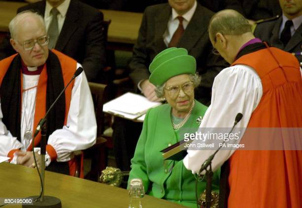 Britain's Queen Elizabeth II recieves a copy of the new book of common worship from the Archbishop of York the most Reverand Dr David Hope at Church...
