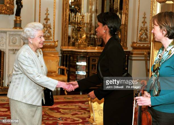Britain's Queen Elizabeth II shakes hands with Condoleezza Rice the US Secretary of State as Louise Miliband the wife of the Foreign Secretary David...