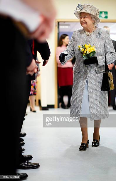 Britain's Queen Elizabeth II shakes hands with staff during her visit to the Queen Elizabeth Hospital in King's Lynn Norfolk east England on February...