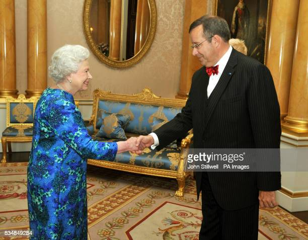 Britain's Queen Elizabeth II shakes hands with the President of Estonia Mr Toomas Hendrik Ilves at Buckingham Palace London