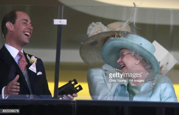 Britain's Queen Elizabeth II shares a joke with the Duke of Wessex as they watch Ouija Board win the Prince of Wales Stakes on the second day of...
