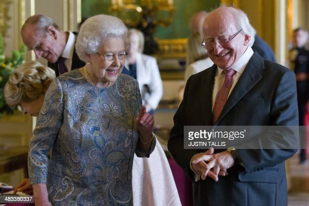 Britain's Queen Elizabeth II shows Irish President Michael D Higgins Irish related items from the Royal Collection in the Green Drawing Room in...