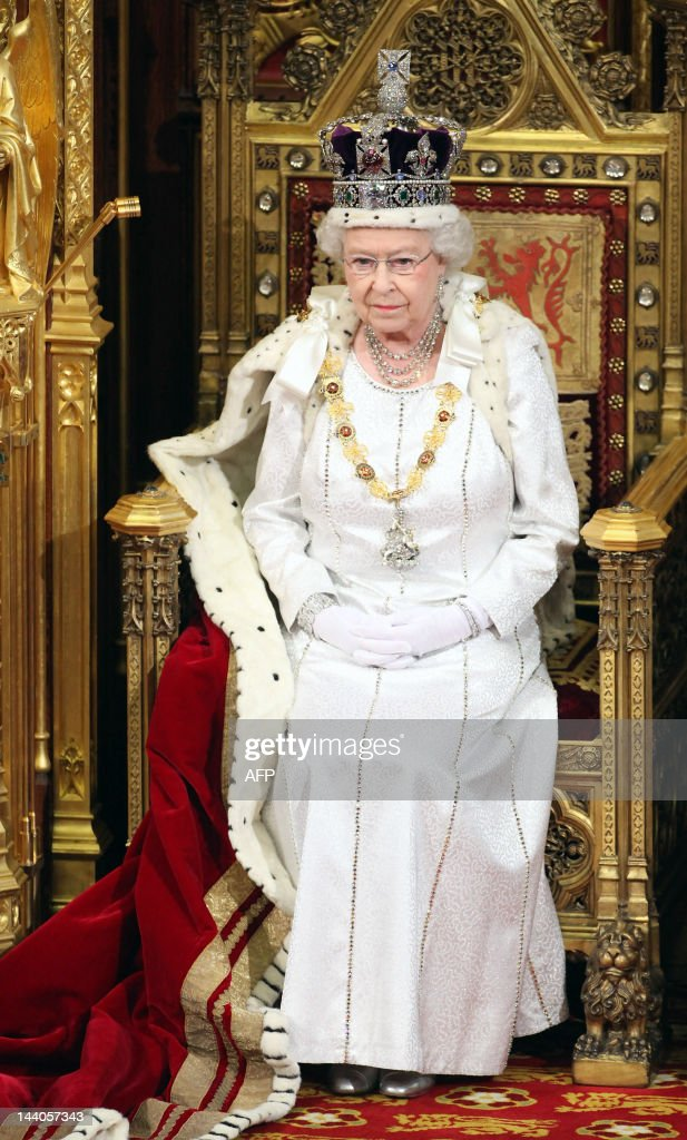 Britain's Queen Elizabeth II sits on the throne in the Chamber of the House of Lords and prepares to read the Queen's Speech during the State Opening...