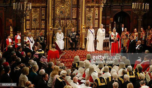 Britain's Queen Elizabeth II sits on the throne waiting for members of the House of Commons to arrive so that she can read the Queen's Speech during...