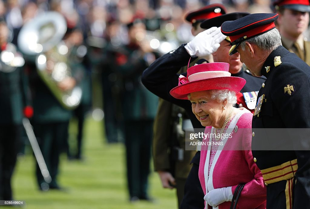 Britain's Queen Elizabeth II (2R) smailes as she arrives to visit Berkhamsted School, north-west of London on May 6, 2016, on the 475th Anniversary of its foundation. The Queen, in her role as Patron of the school, will inspect a Guard of Honour formed from the school's Combined Cadet Force, and view displays celebrating various aspects of school life. Berkhamsted School was founded in 1541 by John Incent, Dean of St Paul's, initially as a school of just 144 pupils. Berkhamsted Schools Group is currently responsible for the education of over 1,800 pupils. / AFP / ADRIAN
