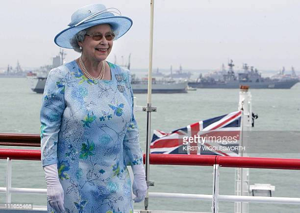 Britain's Queen Elizabeth II smiles aboard the HMS Endurance as she reviews the fleet 28 June 2005 in Portsmouth Britain Hundreds of ships from...