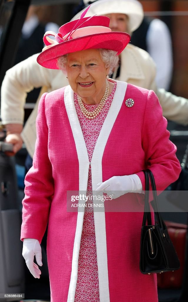 Britain's Queen Elizabeth II smiles as she arrives to visit Berkhamsted School, north-west of London on May 6, 2016, on the 475th Anniversary of its foundation. The Queen, in her role as Patron of the school, will inspect a Guard of Honour formed from the school's Combined Cadet Force, and view displays celebrating various aspects of school life. Berkhamsted School was founded in 1541 by John Incent, Dean of St Paul's, initially as a school of just 144 pupils. Berkhamsted Schools Group is currently responsible for the education of over 1,800 pupils. / AFP / ADRIAN